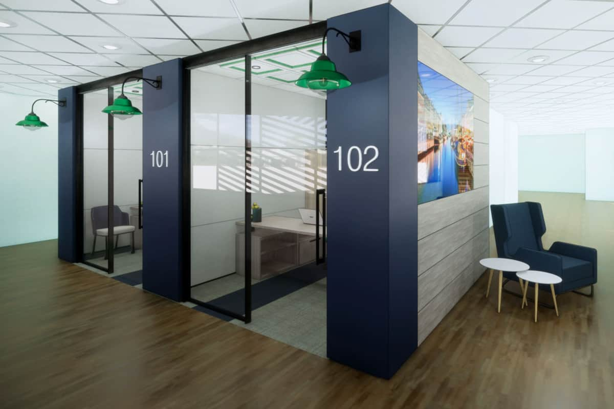 real modern office with cubicles including desks and monitors